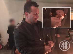 Rob Baker was photographed at the wake held for Fabio Sementilli at the hairdresser's home. A bandage can be seen on the index finger of Baker's left hand [inset].