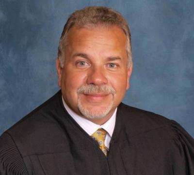 Judge who suggested woman should sell her nude pics to